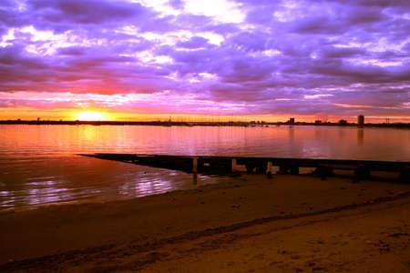 st kilda: Sun setting over the ocean at St Kilda Pier, Melbourne, Australia