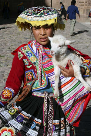 CUSCO, PERU – OCTOBER 28, 2010: Unidentified Indigenous Woman dressed in Traditional Costume, Cusco, Peru, South America