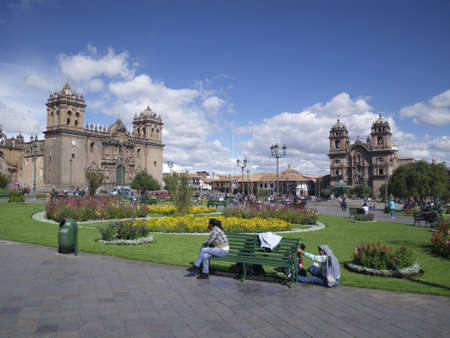 Cuzco, Peru – October 27: People relaxing in the picturesque main square of Cuzco, Peru, South America, October 27, 2010