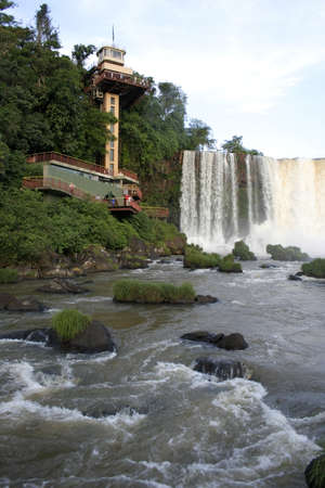 Tourist lift and walkway at the majestic Iguazu Falls, Brazil, South America. Stock Photo