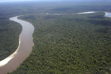 Aerial view of the Amazon River winding through the Amazon jungle Peru, South America