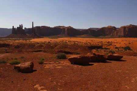 Fantastic shapes of the vast red sandstone buttes of Monument Valley, part of the Colorado Plateau in the Navajo Nation Reservation, Utah, USA