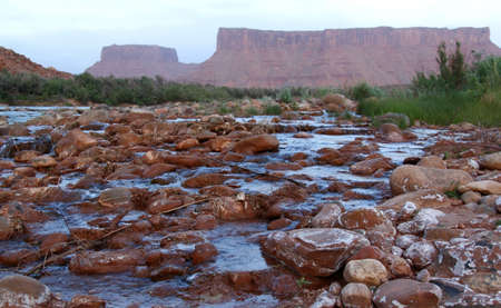 Colorado River flowing over rocks near Moab, famous for whitewater rafting, Utah, USA