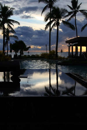 Beautiful tropical resort pool at sunset, Denarau Island, Fiji
