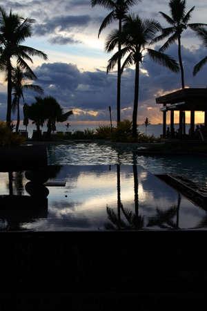 fiji: Beautiful tropical resort pool at sunset, Denarau Island, Fiji
