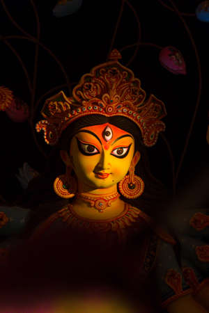 Portrait of Hindu Goddess Durga with spotlight on Her face