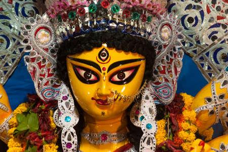 Close up of the beautiful face of Hindu Goddess Durga with use of selective focus.