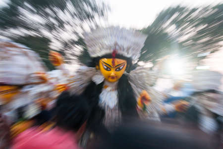 Zoom burst technique, conceptual photography with use of selective focus on the face of Goddess Durga.