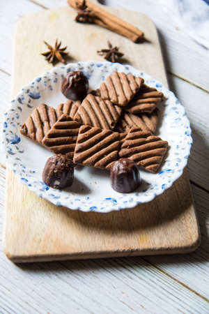 Close up of chocolate cookies in a plate, an ideal food for Christmas celebrations