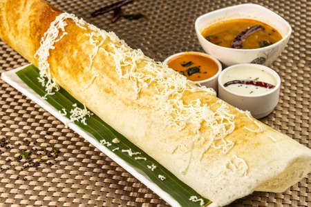 A dosa is a rice pancake, originating from South India, made from a fermented batter.