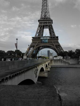 Black and white Paris France Eiffel Tower with a focal color blue sky