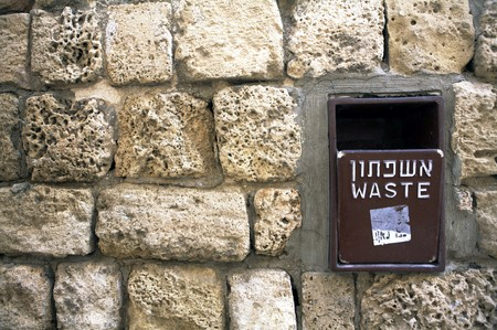 Waste Basket inserted into a Wall photo