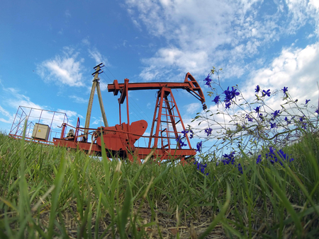lifting jack: Pump jack starting the lifting stroke to brink crude oil up out of a producing oil well Stock Photo