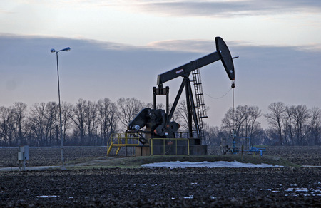 the prairies: Pump jack starting the lifting stroke to brink crude oil up out of a producing oil well Stock Photo