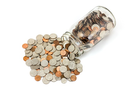 nickle: A spilled jar of US coins on a white background. Stock Photo