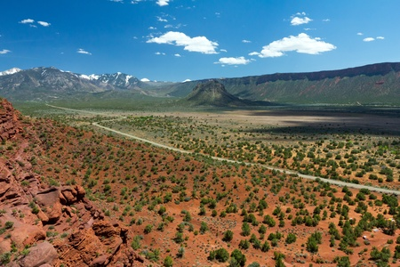 Long road travels through the desert canyons of the American Southwest photo