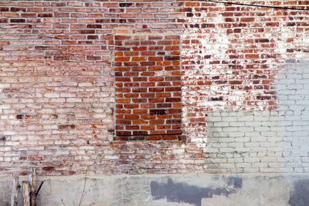 faded: Brick window in grungy old abandoned building