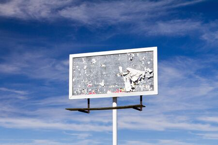 Blank billboard sign with dirty old grunge covered texture against blue sky background Stock Photo