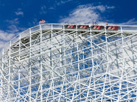 seekers: Thrill seekers rider a rollercoaster as it climbs a hill