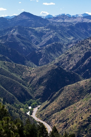 A winding road in the distance snakes through the rugged Colorado mountains  photo