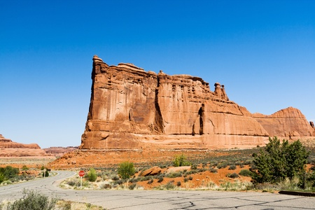 canyonland: Desert road winds through Arches National Park near Moab Utah