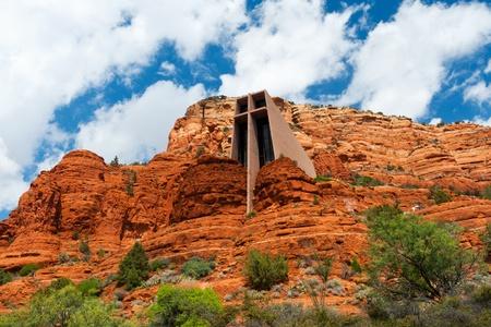 Cross shaped church built into rock cliffs in Arizona photo