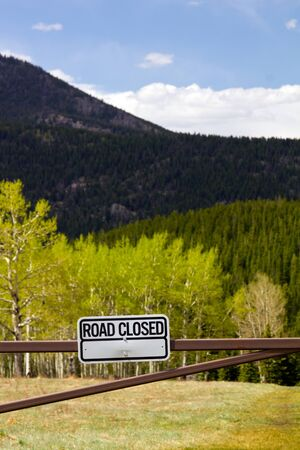 closed sign: Road closed sign to a dirt road in the outdoors Stock Photo