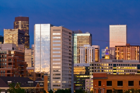 Denver skyline at dusk with colorful sunset reflection in the windows photo