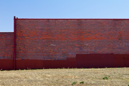 Blank red brick wall of an urban building photo