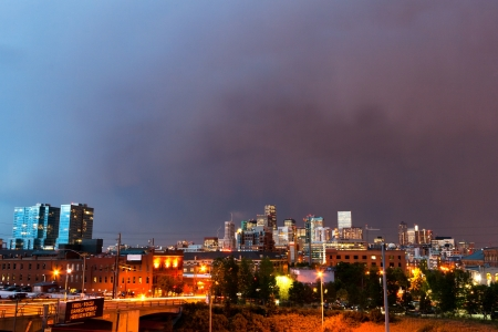 Denver Colorado skyline with setting sun reflecting off buildings at dusk photo