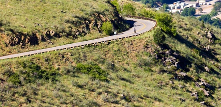Riding a bicycle down a winding mountain road photo