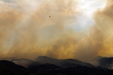 wild fire: Wildfire Burns the Colorado Mountains with a Plane Above
