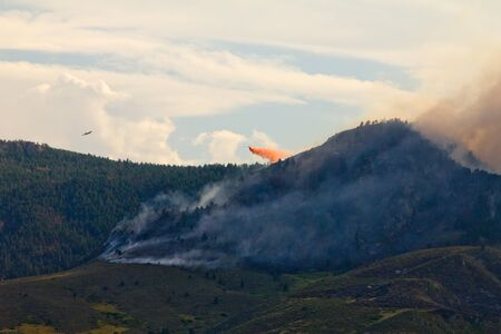 wildfire: Airplane Fire Fighters battle High Park Wildfire in Colorado Stock Photo