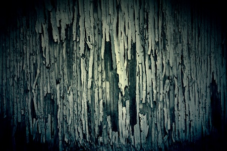 chipped: Dark Texture of peeling paint on grungy old wood