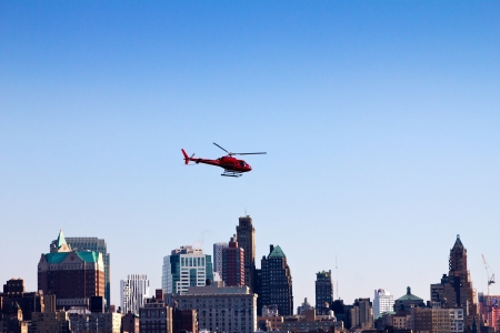 Helicopter flying over the Brooklyn skyline in New York City Editorial