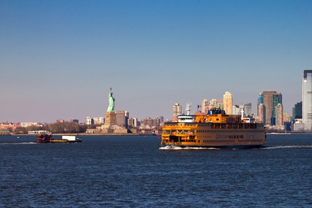 ferries: Staten Island Ferry and Statue of Liberty in New York City Editorial