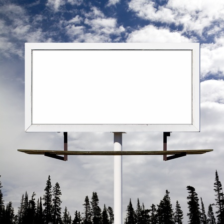 Blank billboard sign against blue sky wilderness background mockup photo