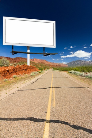desert highway: Blank billboard sign along a loney empty desert highway in Utah