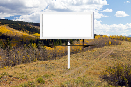 space weather tire: Billboard advertising sign along a mountain trail with golden Fall aspen trees in Colorado