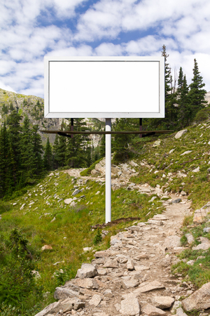 Blank billboard advertising sign along a mountain trail in Colorado Stock Photo