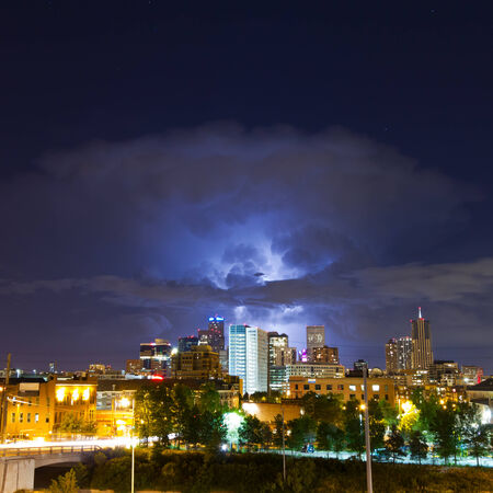 denver skyline with mountains: Lightening flashes from a huge cloud above the Denver, Colorado Skyline Editorial