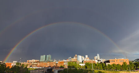 Double rainbow appears over the downtown Denver, Colorado skyline after a big thunderstorm