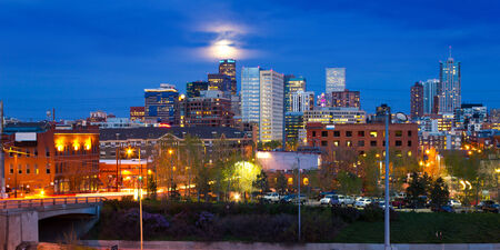 Denver, Colorado downtown skyline with full moon rising above