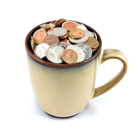 nickle: Cup full of US coins isolated on white background