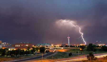 denver: Denver, Colorado - Lightning strike in downtown Denver during a strong spring thunderstorm Stock Photo