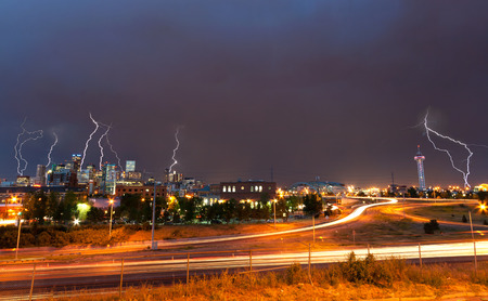 Lightning strikes above the Denver, Colorado downtown skyline during a strong thunderstorm photo