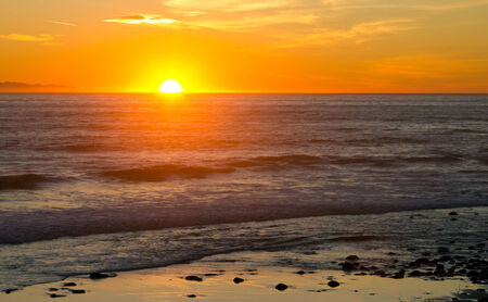 Sunset over the ocean waves landscape background photo