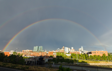 Denver, Colorado - Double rainbow above the downtown skyline after a storm photo