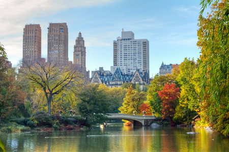 new york buildings: New York City - Central Park in Fall Stock Photo