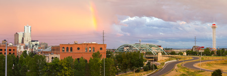 denver skyline with mountains: Colorful rainbow in the sky above Denver, Colorado